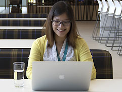 Lady studying on a MacBook Pro